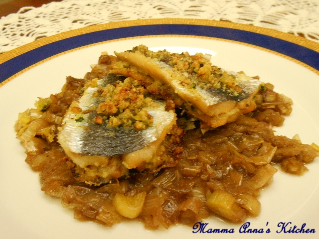 Sandwitch di aringa su porri caramellati all'aceto balsamico